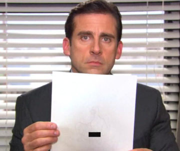 Michael Scott holds up the watermarked paper